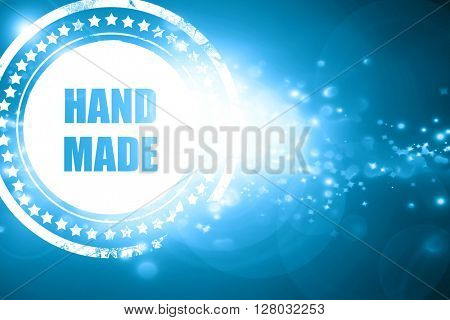 Blue stamp on a glittering background: hand made sign