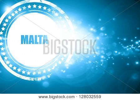 Blue stamp on a glittering background: Greetings from malta
