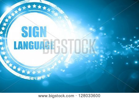 Blue stamp on a glittering background: sign language background