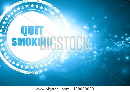 Blue stamp on a glittering background: quit smoking