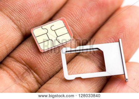 Hand Holding Nano Sim Card And Sim Card Tray