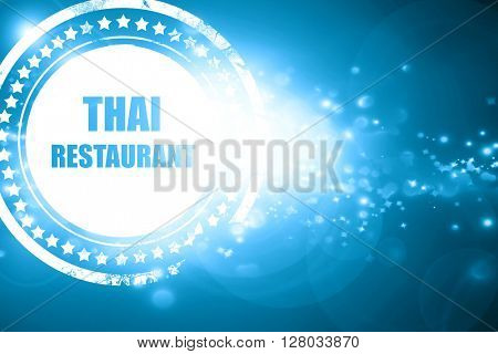 Blue stamp on a glittering background: Delicious thai cuisine