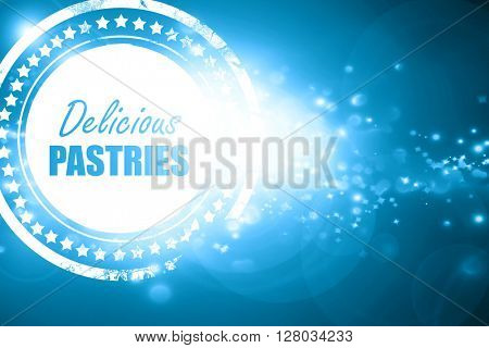 Blue stamp on a glittering background: Delicious pastries sign