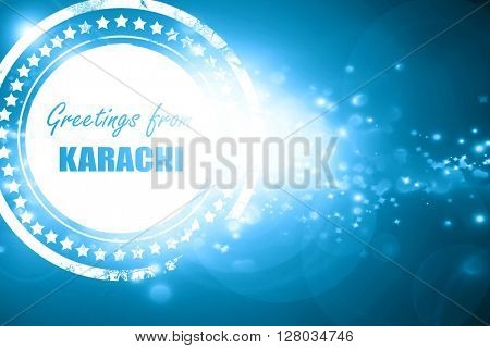 Blue stamp on a glittering background: Greetings from karachi