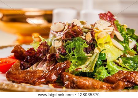 Warm salad with veal and lettuce salad. Close up