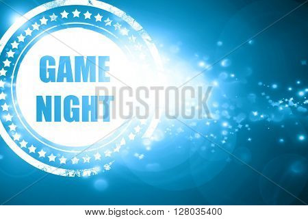 Blue stamp on a glittering background: Game night sign