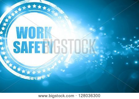 Blue stamp on a glittering background: work safety