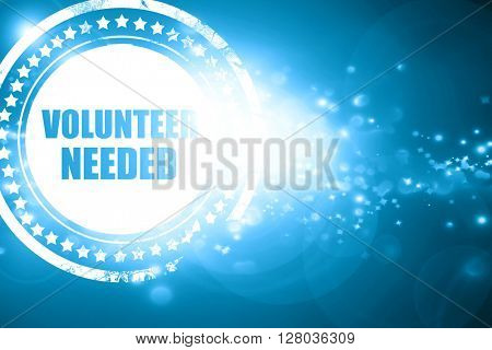 Blue stamp on a glittering background: volunteer needed