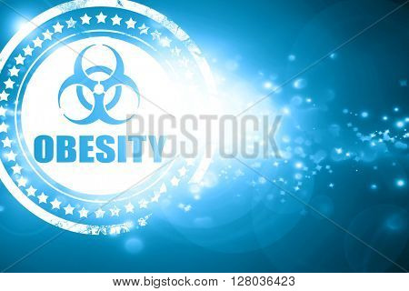 Blue stamp on a glittering background: Obesity concept background