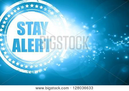 Blue stamp on a glittering background: stay alert