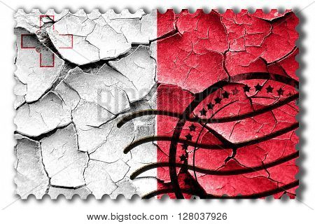 Grunge Malta flag with some cracks and vintage look