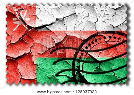 Grunge Oman flag with some cracks and vintage look