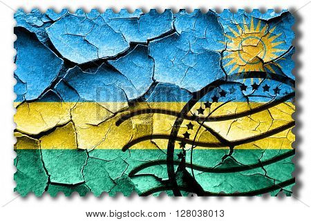 Grunge Rwanda flag with some cracks and vintage look