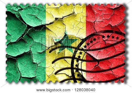 Grunge Senegal flag with some cracks and vintage look