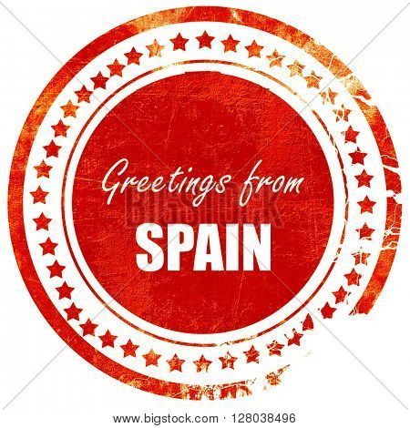 Greetings from spain, grunge red rubber stamp on a solid white b