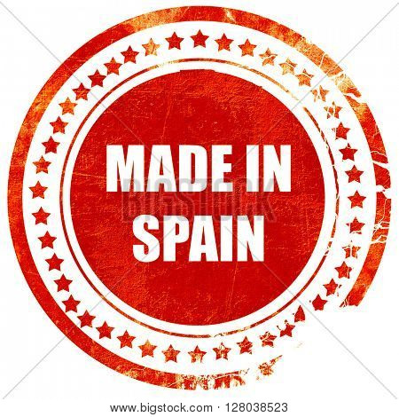 Made in spain, grunge red rubber stamp on a solid white backgrou
