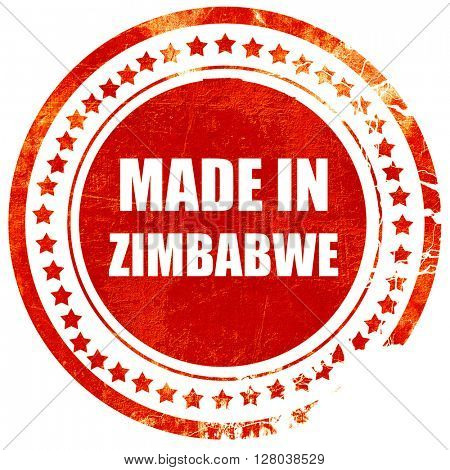 Made in zimbabwe, grunge red rubber stamp on a solid white backg