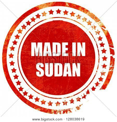 Made in sudan, grunge red rubber stamp on a solid white backgrou