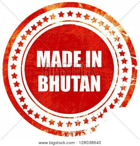 Made in bhutan, grunge red rubber stamp on a solid white backgro