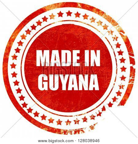 Made in guyana, grunge red rubber stamp on a solid white background