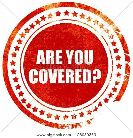 are you covered, grunge red rubber stamp on a solid white backgr