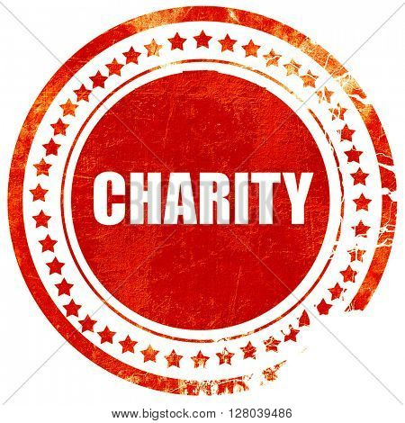 charity, grunge red rubber stamp on a solid white background
