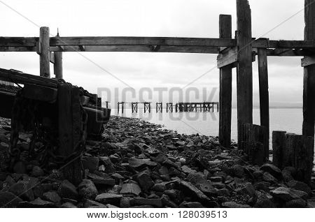 A view of an old ruined wooden pier in Aberdour