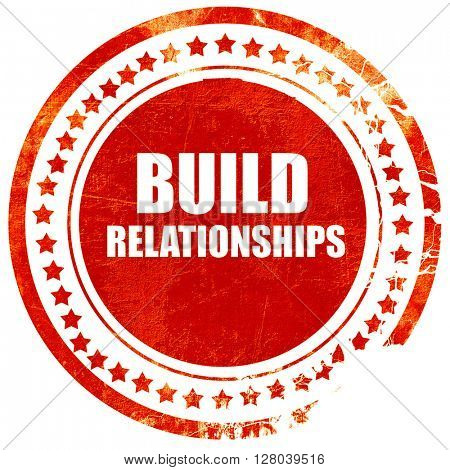 build relationships, grunge red rubber stamp on a solid white ba