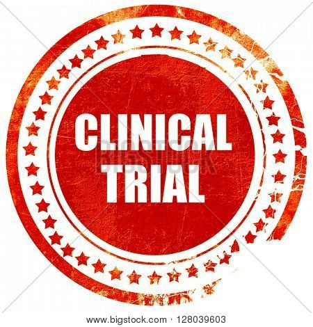 clinical trial, grunge red rubber stamp on a solid white backgro