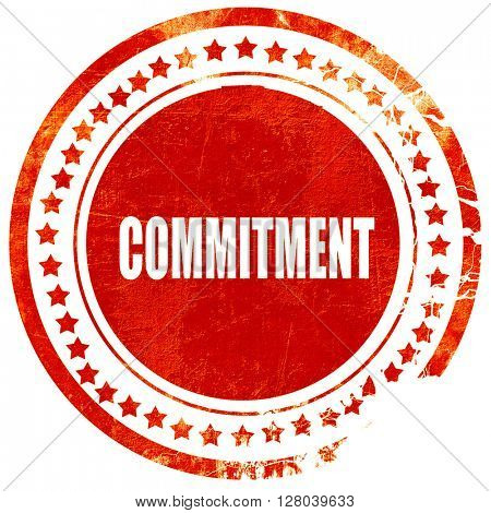 commitement, grunge red rubber stamp on a solid white background