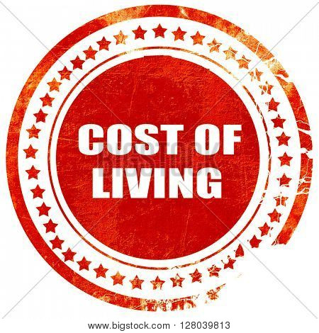 cost of living, grunge red rubber stamp on a solid white backgro