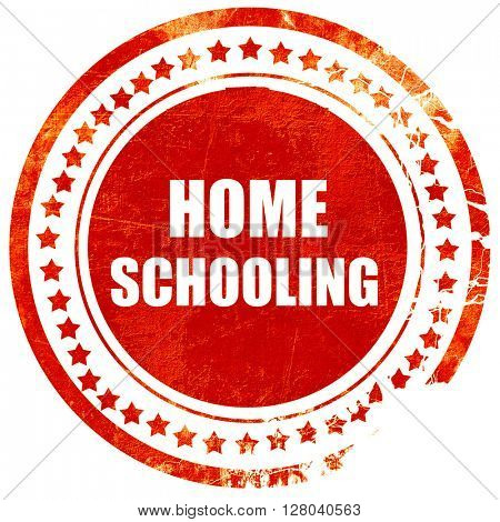 homeschooling, grunge red rubber stamp on a solid white backgrou