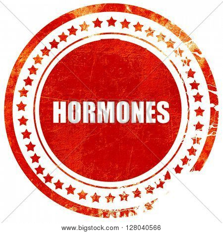 hormones, grunge red rubber stamp on a solid white background