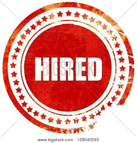 hired, grunge red rubber stamp on a solid white background
