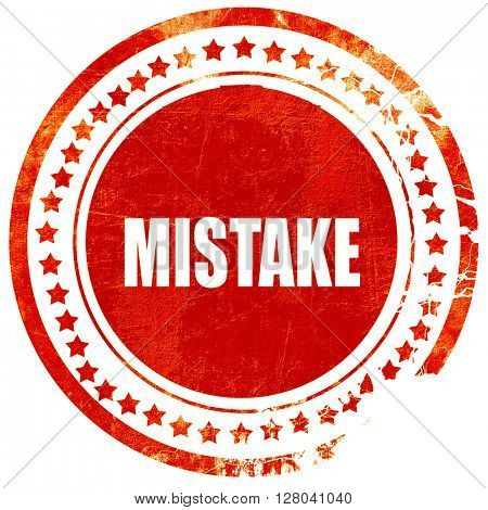 mistake, grunge red rubber stamp on a solid white background
