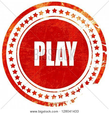 play, grunge red rubber stamp on a solid white background