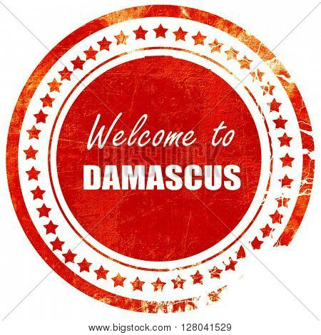 Welcome to damascus, grunge red rubber stamp on a solid white ba