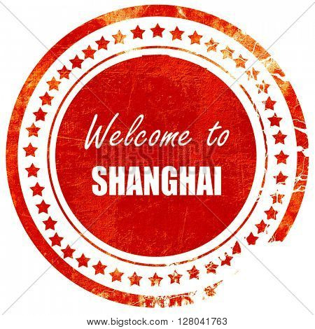 Welcome to shanghai, grunge red rubber stamp on a solid white ba
