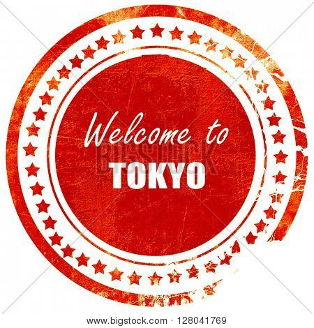 Welcome to tokyo, grunge red rubber stamp on a solid white backg