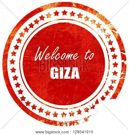 Welcome to giza, grunge red rubber stamp on a solid white backgr