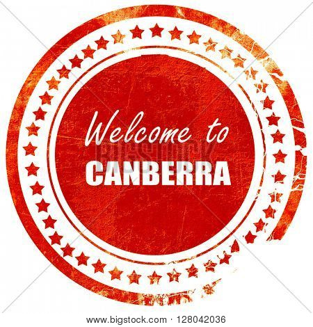 Welcome to canberra, grunge red rubber stamp on a solid white ba