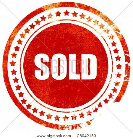 sold sign background, grunge red rubber stamp on a solid white b
