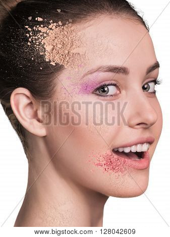 Woman face with crumbly powder isolated on white background