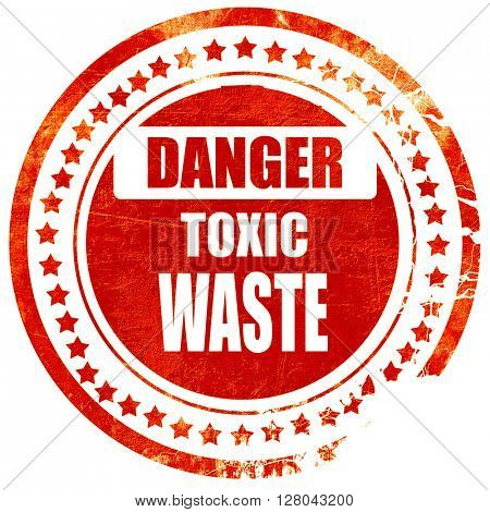 Toxic waste sign, grunge red rubber stamp on a solid white backg