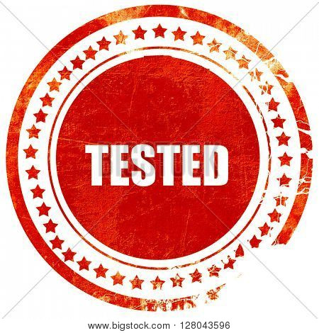 tested sign background, grunge red rubber stamp on a solid white