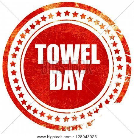 towel day, grunge red rubber stamp on a solid white background