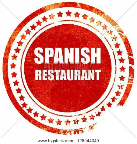 Delicious spanish cuisine, grunge red rubber stamp on a solid wh