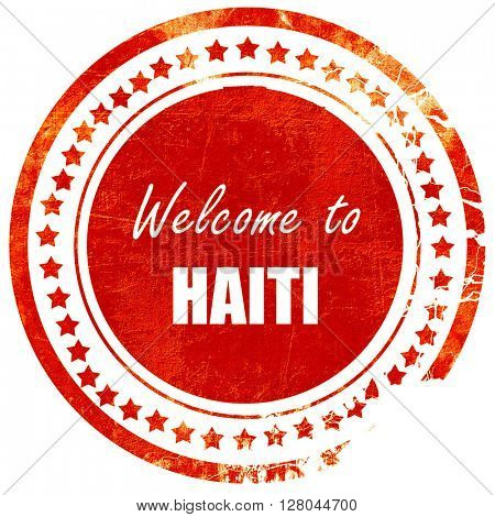 Welcome to haiti, grunge red rubber stamp on a solid white backg