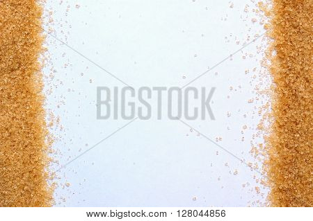 Frame From Brown Cane Sugar On Sides On The White Background