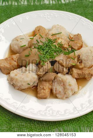 Goulash With Oyster Mushroom And Buckwheat Dumplings On The Green Gunny Cloth